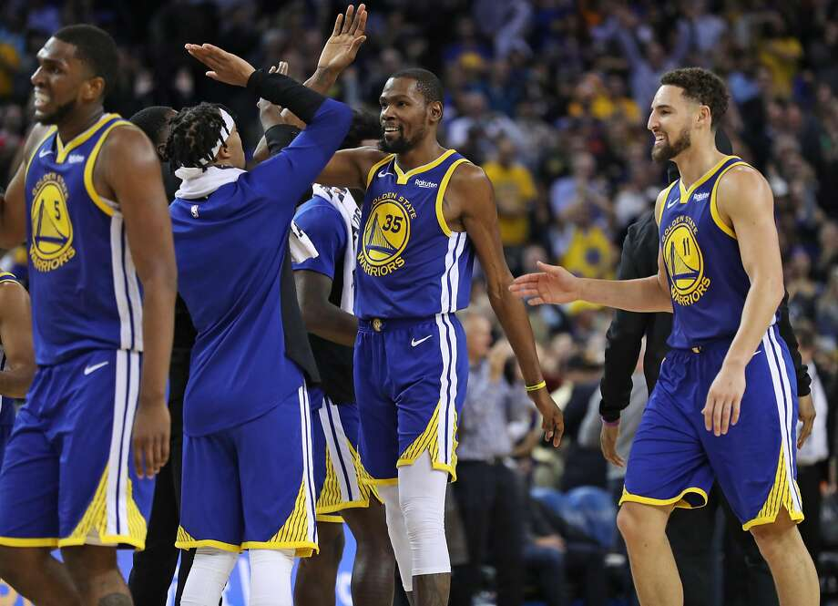 Kevin Durant (35), Klay Thompson (11) and the Warriors are just 1½ games out of the top spot in the Western Conference. Photo: Scott Strazzante / The Chronicle