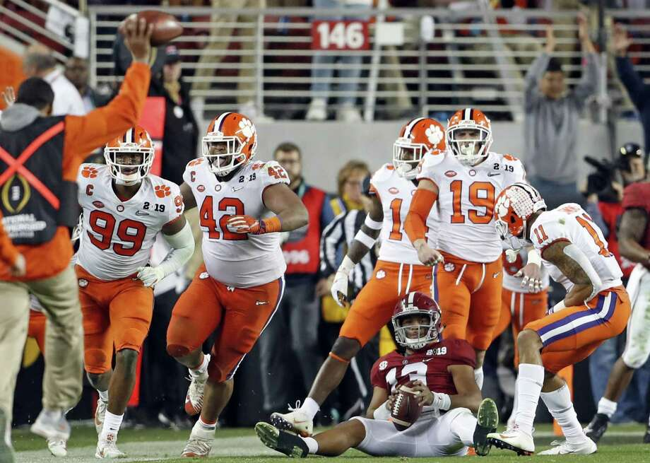 Alabama's Tua Tagovailoa watches Clemson defenders celebrate making a big stop on a fourth-down play in the fourth quarter. Photo: Photos By Scott Strazzante / The Chronicle / Scott Strazzante
