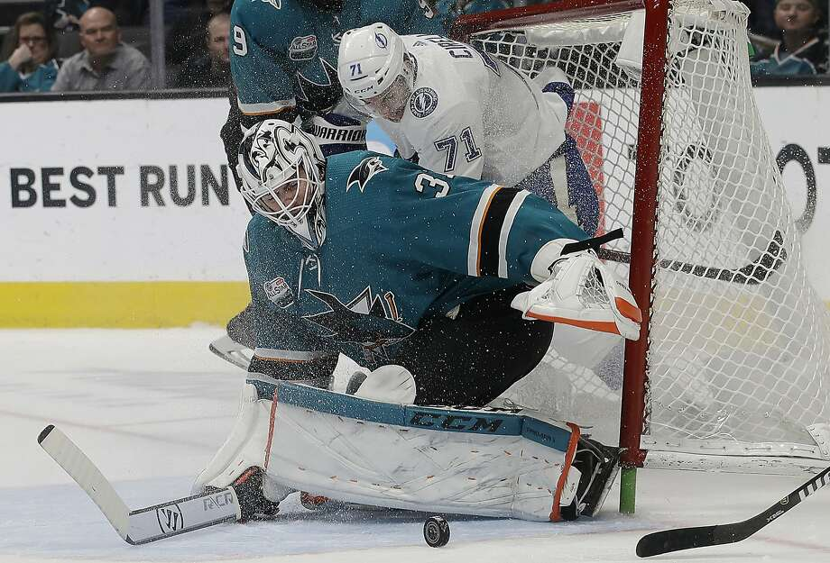 San Jose Sharks goalie Martin Jones (31) defends the net in front of Tampa Bay Lightning center Anthony Cirelli (71) during the second period of an NHL hockey game in San Jose, Calif., Saturday, Jan. 5, 2019. (AP Photo/Jeff Chiu) Photo: Jeff Chiu / Associated Press
