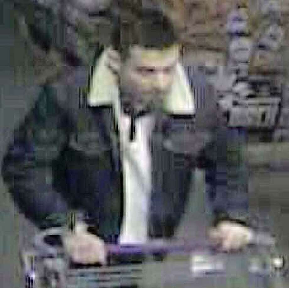 Police are asking the public's help to ID a man who stole Red Bull energy drinks from Stop & Shop in Westport during the first weekend in January. Photo: /