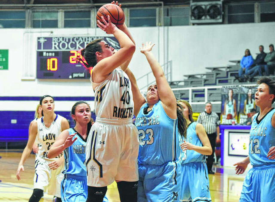 Routt's Katie Abell puts up a shot in the first half Monday against North Mac in the Routt Dome. Photo: Audrey Clayton | Journal-Courier