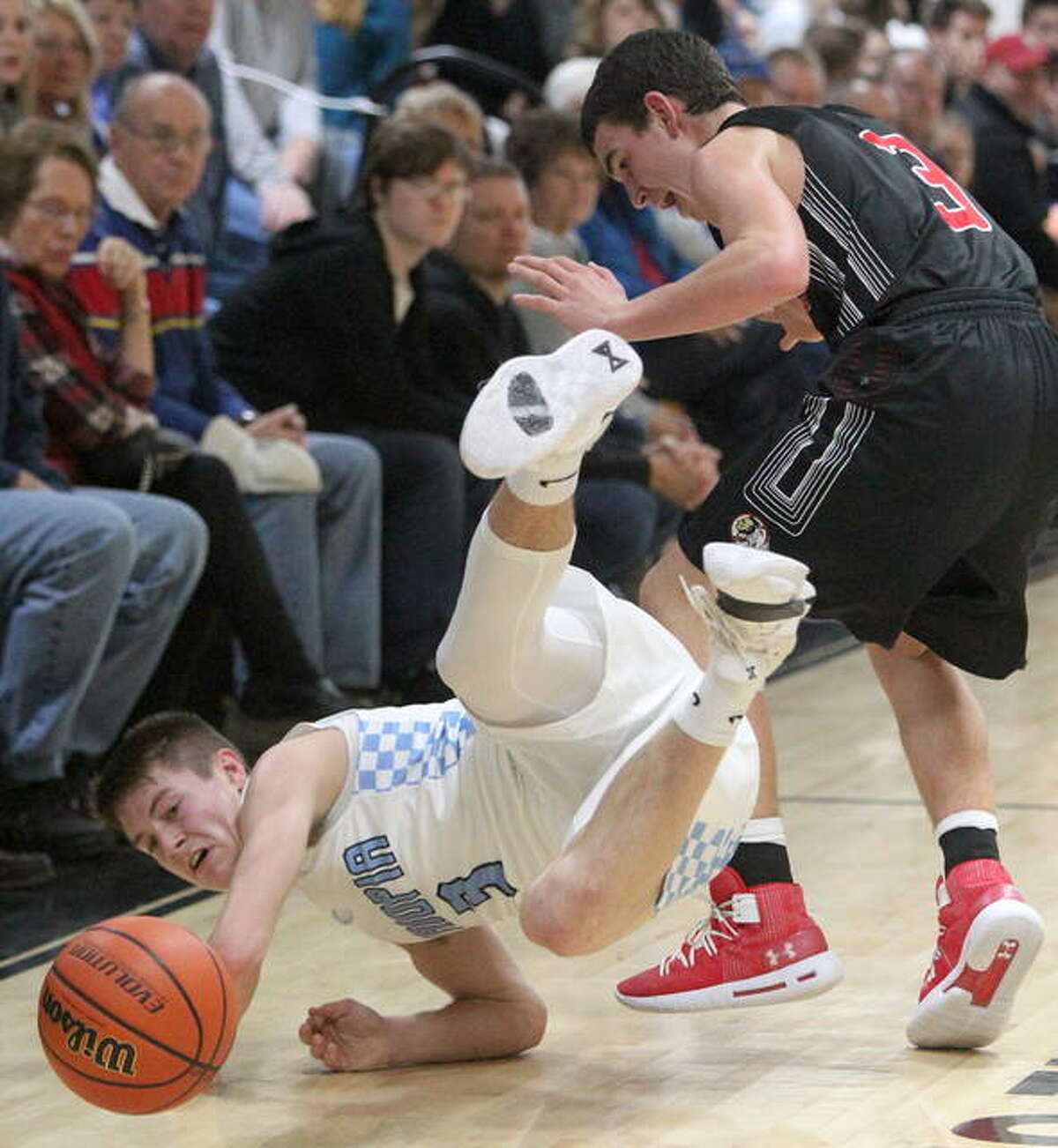 Triopia's Zach Thompson dives after a loose ball during a boys' basketball game against Calhoun at the Winchester Invitational Tournament Monday night. Triopia's Garrett Snow heads for the basket Monday night at Winchester.