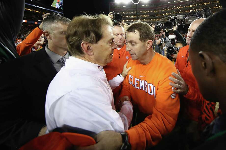 PHOTOS: How each conference did during bowl season  SANTA CLARA, CA - JANUARY 07:  Head coach Dabo Swinney of the Clemson Tigers meets head coach Nick Saban of the Alabama Crimson Tide at mid-field after his 44-16 win in the CFP National Championship presented by AT&T at Levi's Stadium on January 7, 2019 in Santa Clara, California.  >>>Browse through the slideshow for a look at records for each conference during the college football bowl season ...  Photo: Ezra Shaw, Getty Images / 2019 Getty Images