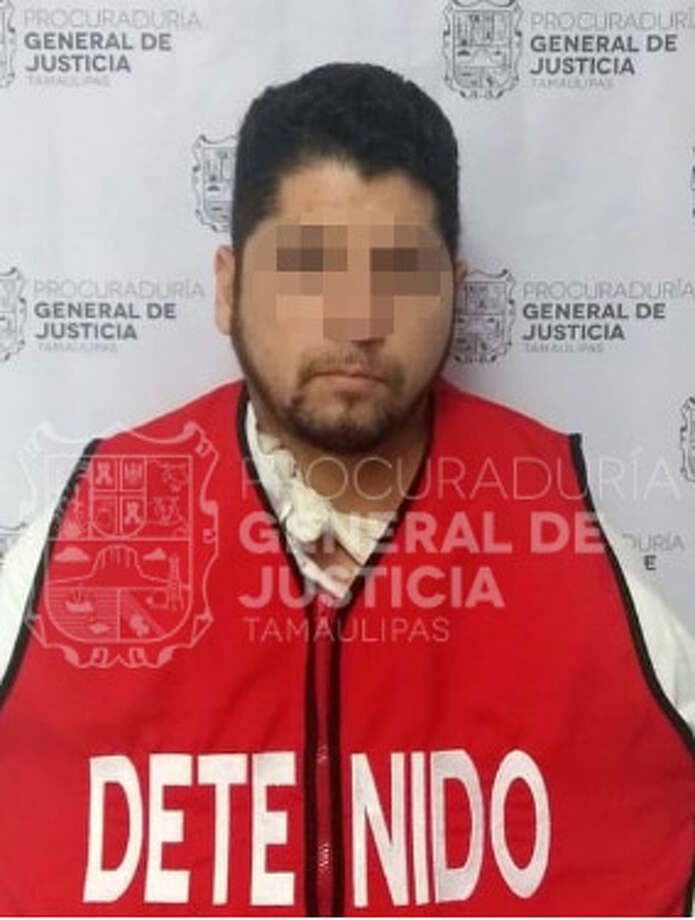 In this photo, Tamaulipas authorities blur the face of Carlos Perez Garcia, who was recently arrested on allegations that he killed two cops in Nuevo Laredo, Mexico. Photo: Courtesy