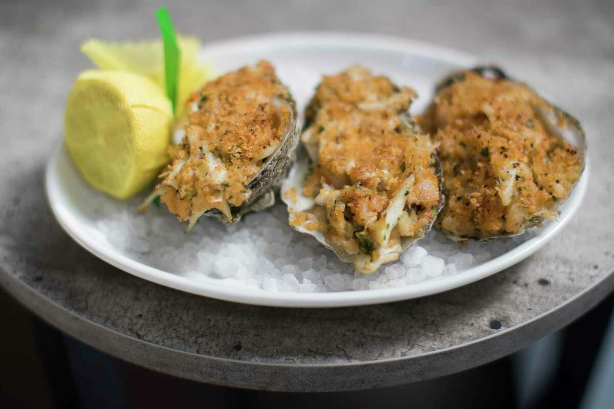 Hearth-roasted oysters with shrimp, blue crab and brown butter breadcrumbs at Eunice