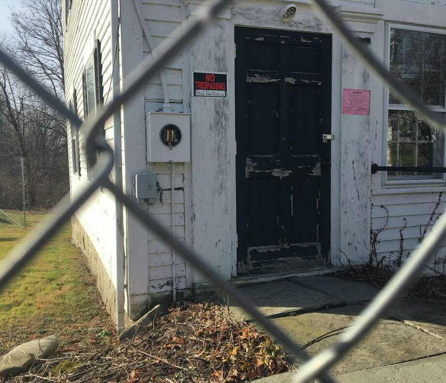 The town's insurance provider has required no trespassing and warning signs be posted and a fence be installed around the Bridgewater Grange. Costs are needed to determine if the historic building should be restored or replaced with a new building. Pohotographed on Jan. 7, 2019. Photo: H John Voorhees III / Reporter / The News-Times
