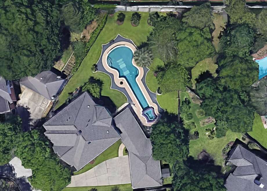 Teguh Inarsoyo of Katy loves guitars so much he constructed a 60-foot in-ground swimming pool modeled after the Gibson Les Paul 1960 Classic edition in his backyard. Photo: Google Maps