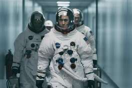 """Ryan Gosling stars as Neil Armstrong in a scene from """"First Man."""" (Daniel McFadden/Universal Pictures via AP)"""
