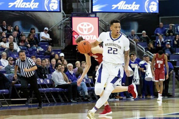 SEATTLE, WA - JANUARY 05: Washington Huskies forward Dominic Green (22) dribbles the ball down court during a Boeing Apple Cup Series college basketball game between the Washington State Cougars against the Washington Huskies on January 05, 2019, at Alaska Airlines Arena at Hec Edmundson Pavilion in Seattle, WA. (Photo by Joseph Weiser/Icon Sportswire via Getty Images)