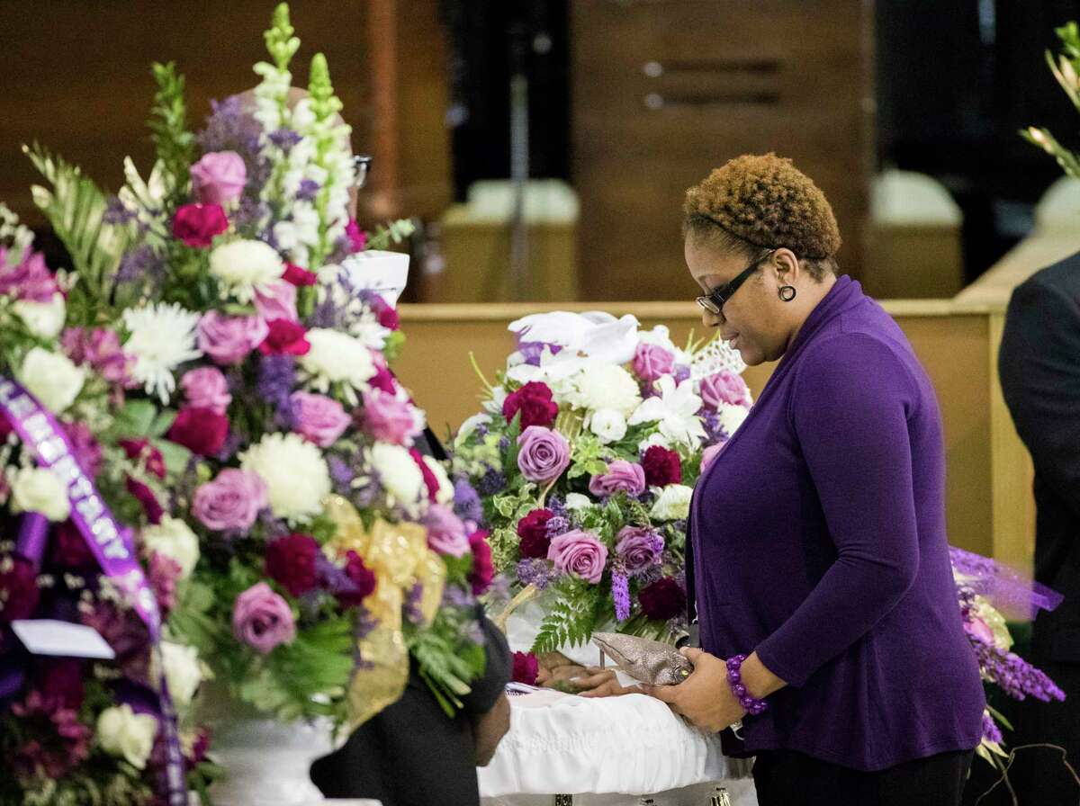 A mourner approaches the casket of Jazmine Barnes during a viewing ceremony before the memorial services of the seven-year-old on Tuesday at the Community of Faith Church, Jan. 8, 2019, in Houston.