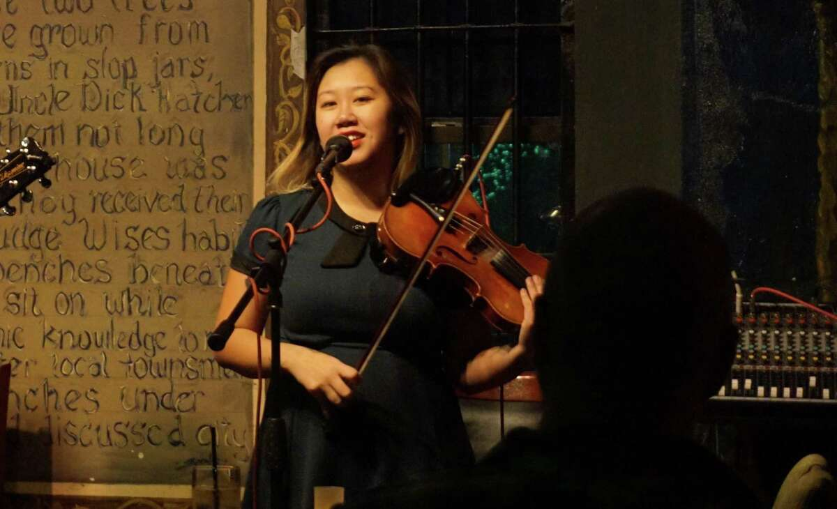 Violinist and vocalist Sonya Nguyen at an event in Green Oaks Tavern.