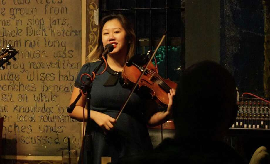 Violinist and vocalist Sonya Nguyen at an event in Green Oaks Tavern. Photo: Nguyen Le / Staff Photo
