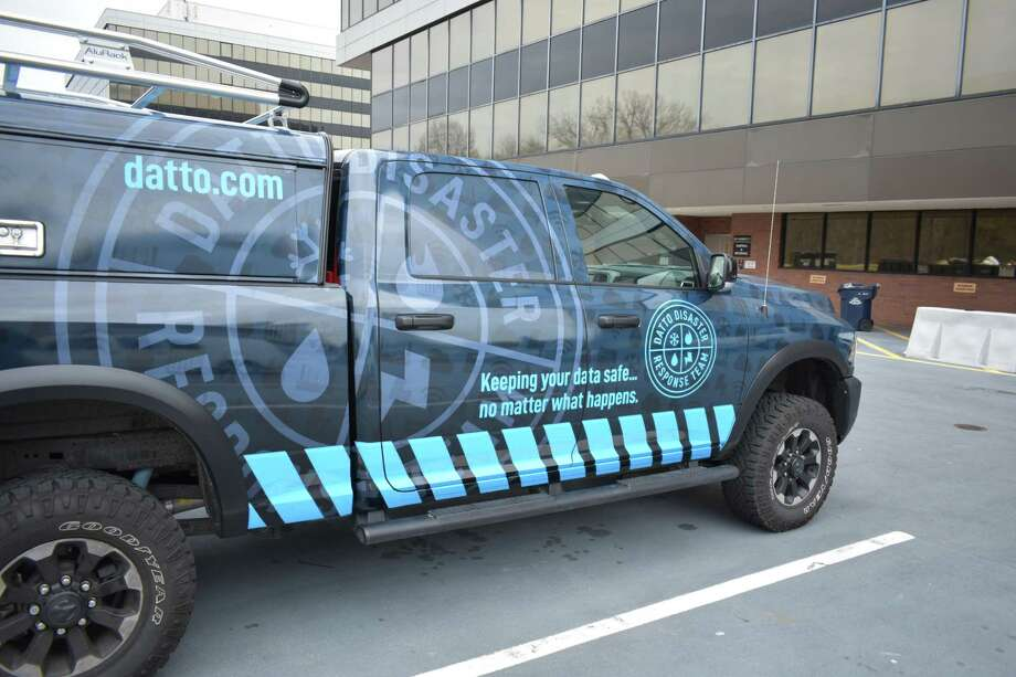 A Datto truck in February 2018 at the Merritt 7 Office Park where the data backup and security firm has its headquarters as one of the fastest-growing companies in Connecticut. Photo: Alexander Soule / Hearst Connecticut Media / Stamford Advocate