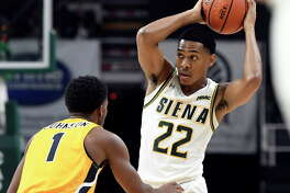 Canisius guard Malik Johnson (1) defends against Siena guard Jalen Pickett (22) during the first half of an NCAA college basketball game Saturday, Jan. 5, 2019, in Albany, N.Y.