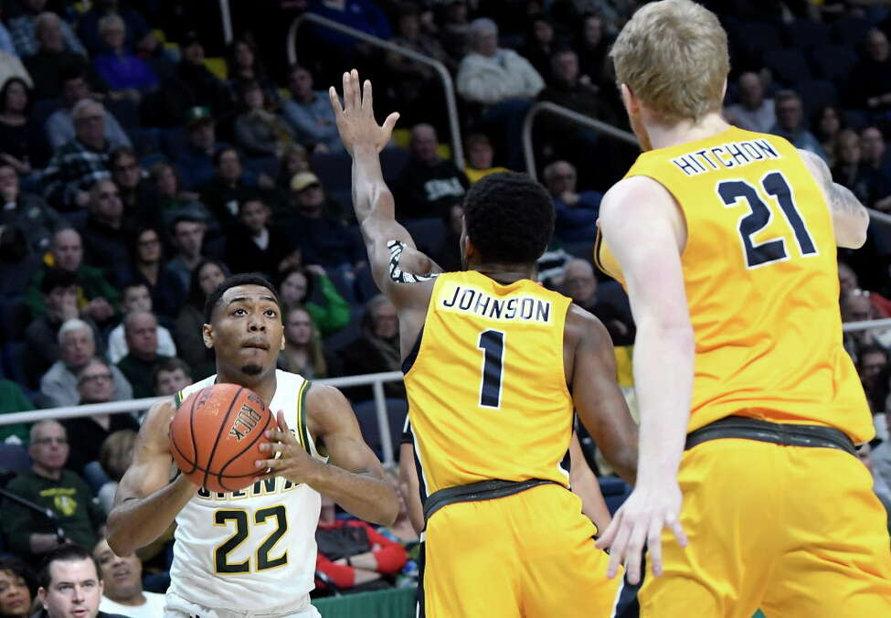 Siena guard Jalen Pickett (22) puts up a shot over Canisius guard Malik Johnson (1) and forward Scott Hitchon (21)during the first half of an NCAA college basketball game Saturday, Jan. 5, 2019, in Albany, N.Y.