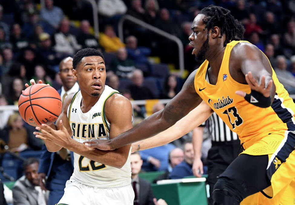 Siena guard Jalen Pickett (22) moves the ball against Canisius guard Isaiah Reese (13)during the first half of an NCAA college basketball game Saturday, Jan. 5, 2019, in Albany, N.Y.