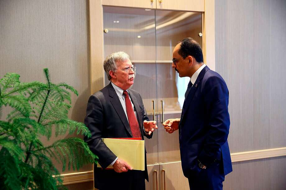 Presidential spokesman Ibrahim Kalin (right) speaks with National Security adviser John Bolton. Photo: AFP / Getty Images