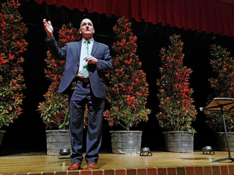 Crosby ISD Superintendent Scott Davis gives the district's yearly convocation in front of seven magnolia trees at Crosby High School on Jan. 7, 2019. These magnolia trees represent the seven Crosby ISD campuses. Photo: Kaila Contreras