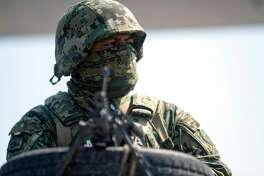 A member of the Navy stands guard at a checkpoint in the border city of Reynosa, Tamaulipas state, Mexico on April 6, 2018. Reynosa is one of the most violent cities in northeastern Mexico. / AFP PHOTO / Julio Cesar AGUILAR (Photo credit should read JULIO CESAR AGUILAR/AFP/Getty Images)