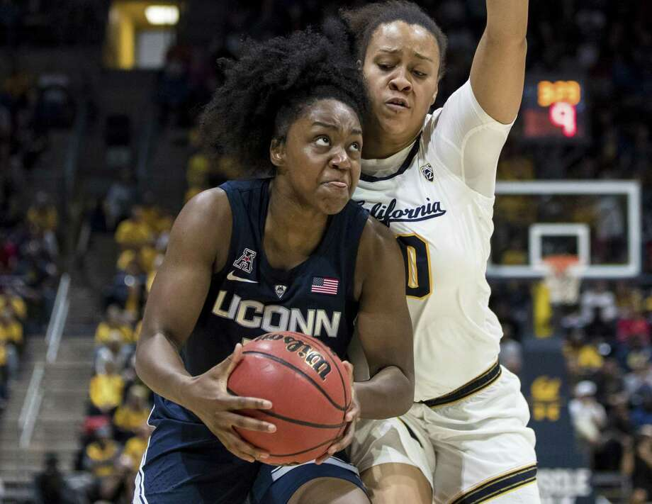 UConn freshman guard Christyn Williams, left, looks to shoot as California guard McKenzie Forbes defends Dec. 22 in Berkeley, Calif. Photo: John Hefti / Associated Press / Copyright 2018 The Associated Press. All rights reserved