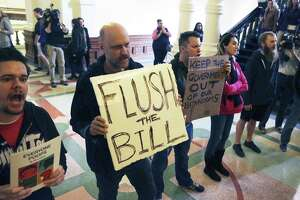 Protestors bhant in the hall as Lt. Governor Dan Patrtick announces legislation by Senator Lois Kolkhorst (R-Brenham) concerning bathroom access rules in Texas on January 5, 2017.