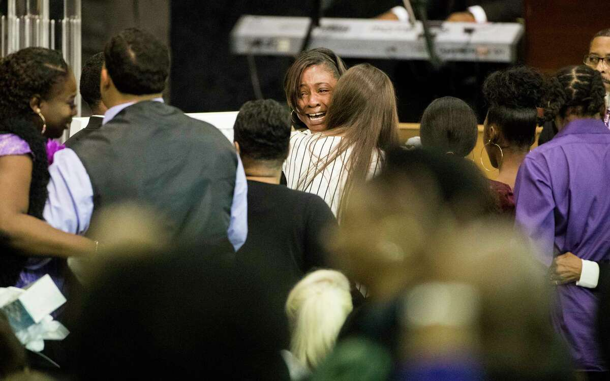 LaPorsha Washington, mother of Jazmine Barnes cried on the shoulders of loved ones by the casket of her daughter during the seven-year-old's memorial service, Tuesday, Jan. 8, 2019, in Houston.