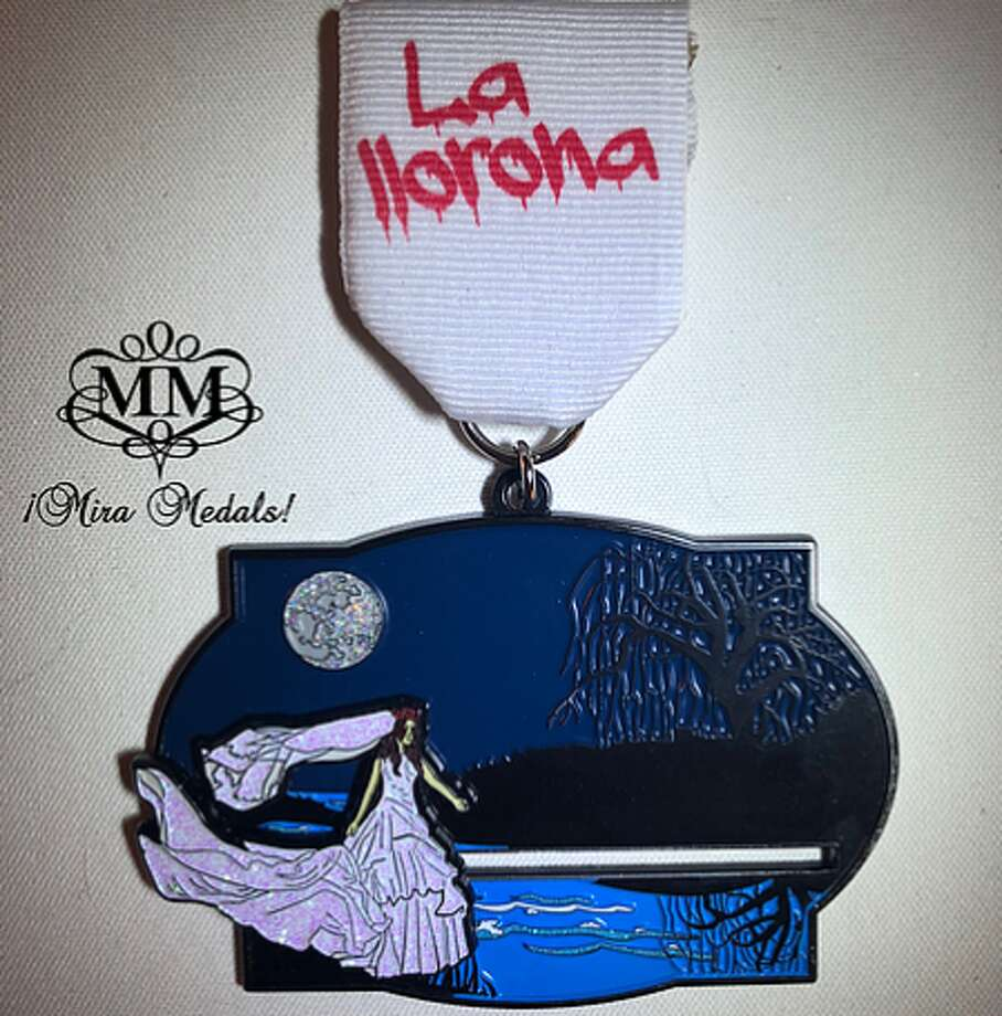 Mira Medals, owned by husband-wife duo Albert and Natasha Gonzales, designed the La Llorona pin for Fiesta 2019 that's packed with fun features. Photo: Courtesy, Mira Medals
