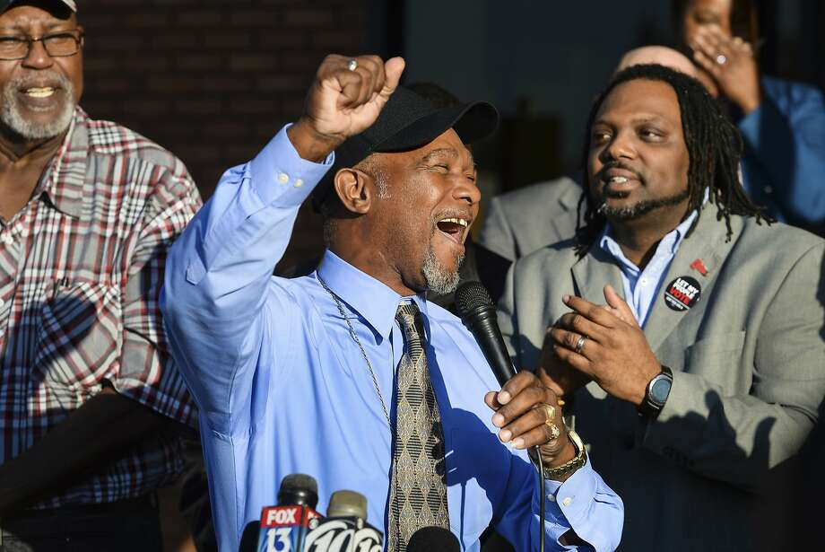 Pastor Wesley Tunstall praises God while addressing media at the Sarasota County Supervisor of Elections Office on Tuesday, Jan. 8, 2019, in Sarasota, Fla. Tunstall, a convicted felon, registered to vote on Tuesday, the first day that Amendment 4, which restores the right to vote for most felons, went into effect.  (Dan Wagner/Sarasota Herald-Tribune via AP) Photo: Dan Wagner, Associated Press