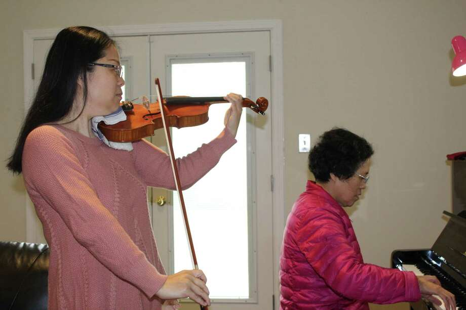 Though Jenny Stern is a resident of The Woodlands and a member of The Woodlands Symphony Orchestra, she's originally from Shanghai, China. Here, she plays a piece with her mother. Photo: Jane Stueckemann / The Villager