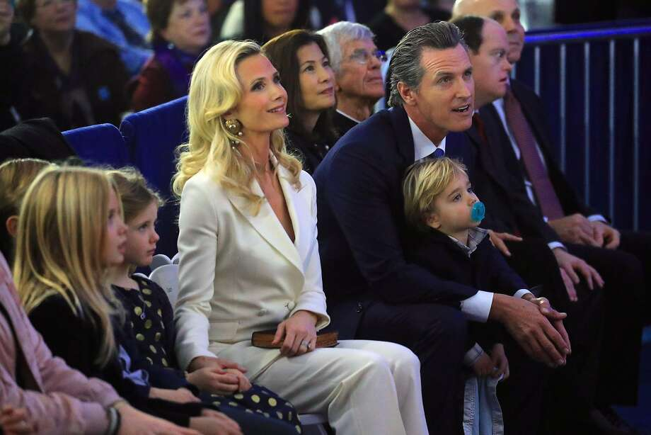 Gavin Newsom during his inauguration ceremony as California's 40th governor, alongside his wife, Jennifer Siebel Newsom, and their children, at the State Capitol in Sacramento. Photo: Jim Wilson / New York Times