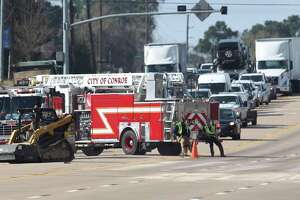 Law enforcement and Hazmat crews work to clean up a spill after an 18-wheeler spilt methanol and shut down Texas 105 West near April Sound for several hours, Tuesday, Jan. 8, 2019, in Conroe. No injuries were reported.