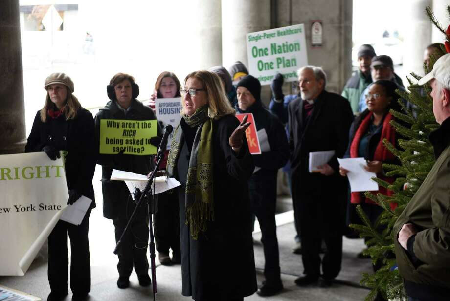 Susan Zimet, executive director of Hunger Action Network of NewYork State, speaks during the 30th Peoples State of the State rally on Tuesday, Jan. 8, 2019, outside the Capitol on State St. in Albany, N.Y. (Will Waldron/Times Union) Photo: Will Waldron, Albany Times Union