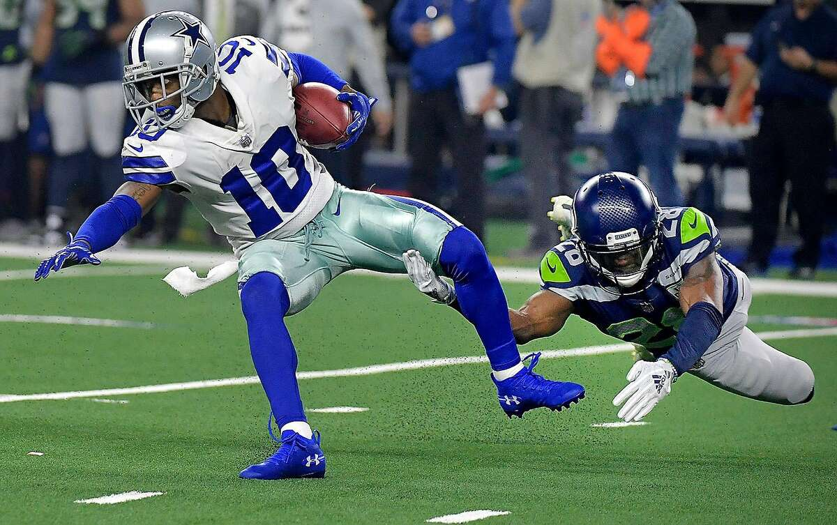 Dallas Cowboys wide receiver Tavon Austin (10) is tackled by Seattle Seahawks cornerback Justin Coleman (28) on a first-quarter punt return in an NFL Wild Card playoff game at AT&T Stadium in Arlington, Texas, on Saturday, Jan. 5, 2019.