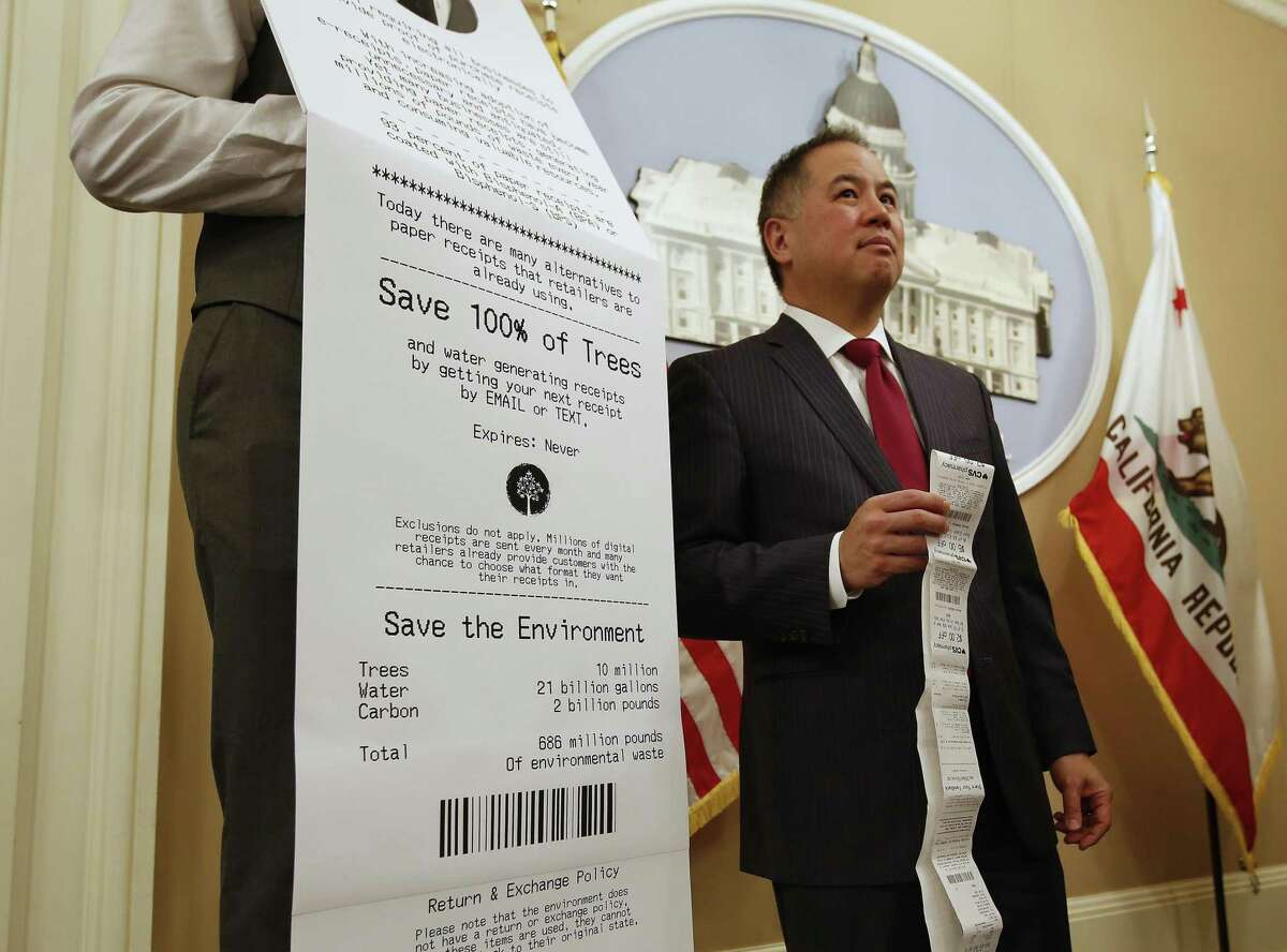 Assemblyman Phil Ting, D-San Francisco, displays a long paper receipt as he discusses his bill to require businesses to offer electronic receipts. He announced the introduction of AB161 in Sacramento Tuesday. Under the legislation, customers could receive a paper receipt on request.