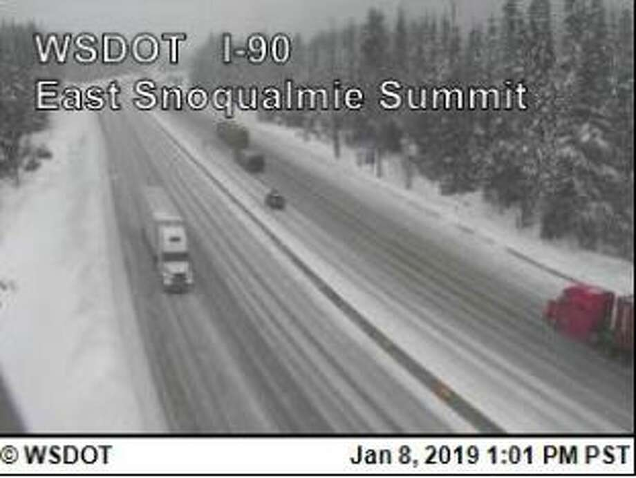 Chains were required on Snoqualmie Pass Tuesday afternoon due to snow on the roads. Photo: Courtesy WSDOT