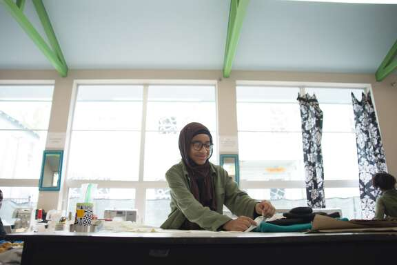 A student works on a creation in Workshop Houston's Style Shop.