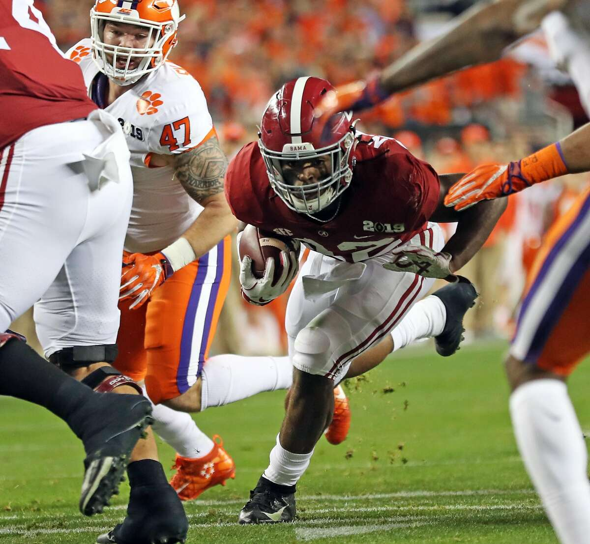 Alabama's Najee Harris rushes for a first down in 2nd quarter against Clemson during College Football Playoff championship game at Levi's Stadium in Santa Clara, Calif. on Monday, January 7, 2019.