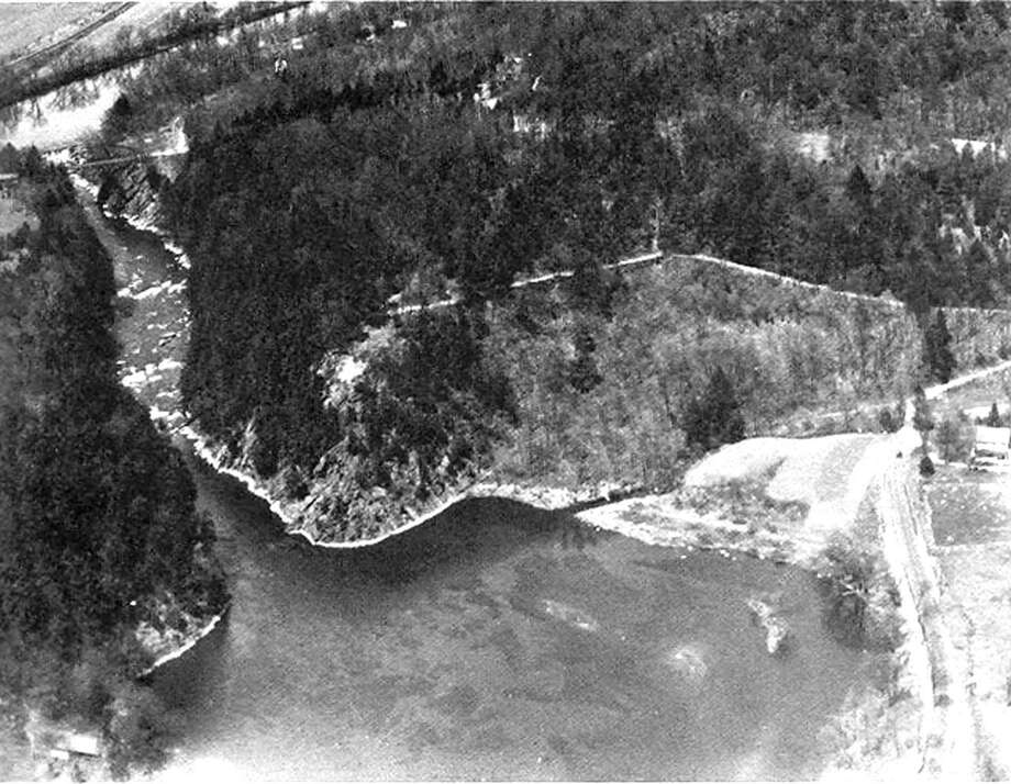 "A n April 16, 1946 view of the Lover's Leap Gorge in New Milford, looking north from above Lake Lillinonah toward the Housatonic River, showing the Lover's Leap Bridge spanning the gorge 31 years before the Charles H. Marsh Memorial Bridge was constructed as its replacement for motor traffic. To the lower right is North Lillinonah Lake Road. If you have a ""Way Back When"" photograph you'd like to share, contact Deborah Rose at drose@newstimes.com or 860-355-7324. Photo: Courtesy Of ""Howard Peck's New Milford"" / The News-Times Contributed"