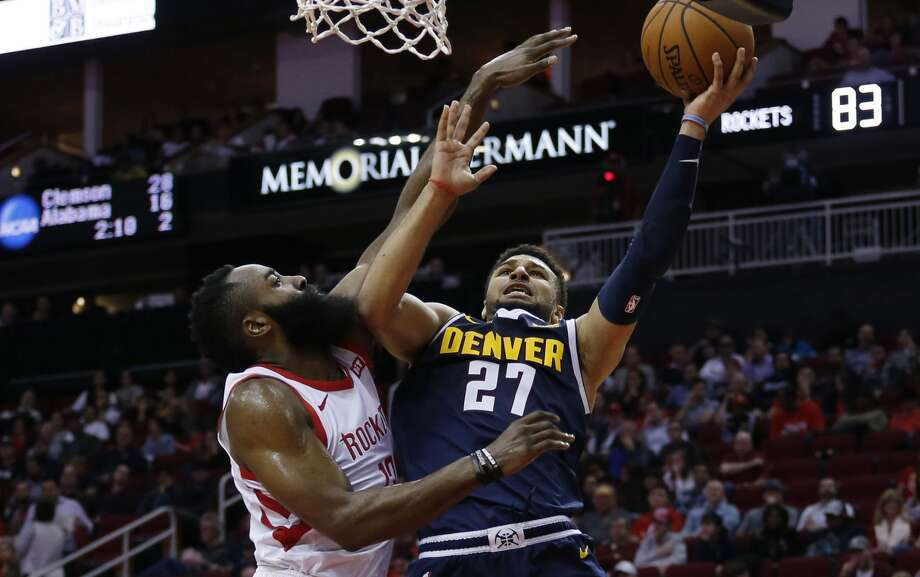 HOUSTON, TEXAS - JANUARY 07: Jamal Murray #27 of the Denver Nuggets is fouled by James Harden #13 of the Houston Rockets as he drives to the basket during the third quarter at Toyota Center on January 07, 2019 in Houston, Texas.  (Photo by Bob Levey/Getty Images) Photo: Bob Levey/Getty Images