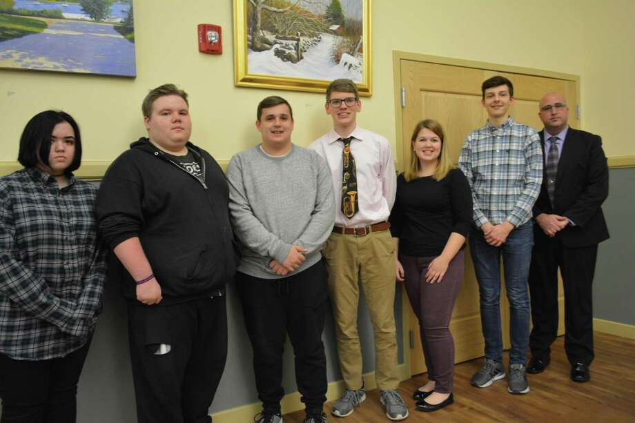 Members of the Torrington High School Band were honored Monday by the City Council for their invitation to the All-State Conference. From left are students Kayla Damon, Jacob Cousens, Matthew Ammerman, Nathan Swart, Julia Fritz, Jayson Baubel and THS Band Director Wayne Splettstoeszer. Photo: Leslie Hutchison / Hearst Connecticut Media /