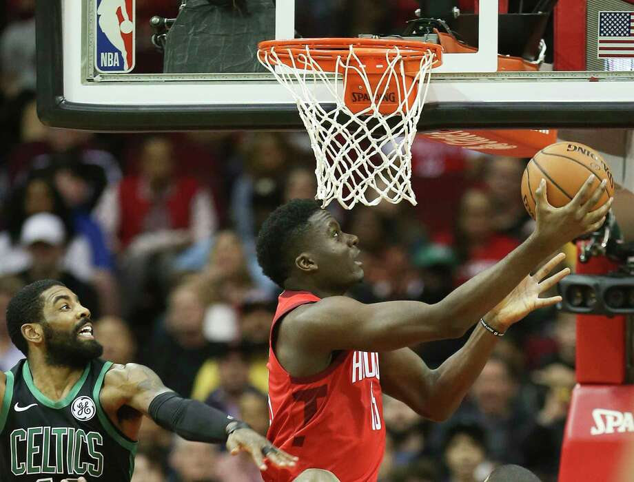 PHOTOS: Former Texas high school stars in the NBA  Houston Rockets center Clint Capela (15) goes up for a reverse layup against Boston Celtics guard Kyrie Irving (11) in the first half of NBA game action at the Toyota Center on Thursday, Dec. 27, 2018 in Houston. Capela had 38 points in the Rockets' 127-113 win.  >>>Here's a look at players on 2018-19 NBA rosters who played high school basketball in the state of Texas ...  Photo: Elizabeth Conley, Staff Photographer / © 2018 Houston Chronicle
