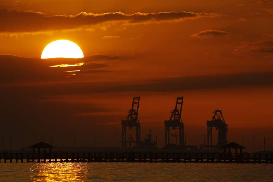 Despite growth signified by cranes like these in Gulfport, Miss., the Wold Bank is downgrading its outlook for the global economy this year. Photo: Charlie Riedel / Associated Press