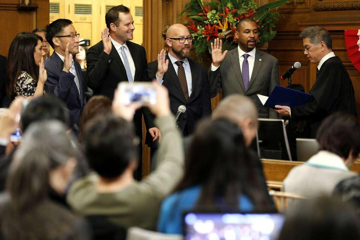 From left: Catherine Stefani, Gordon Mar, Matt Haney, Rafael Mandelman and Shamann Walton are sworn in to the Board of Supervisors at City Hall on Tuesday, Jan. 8, 2019, in San Francisco, Calif.