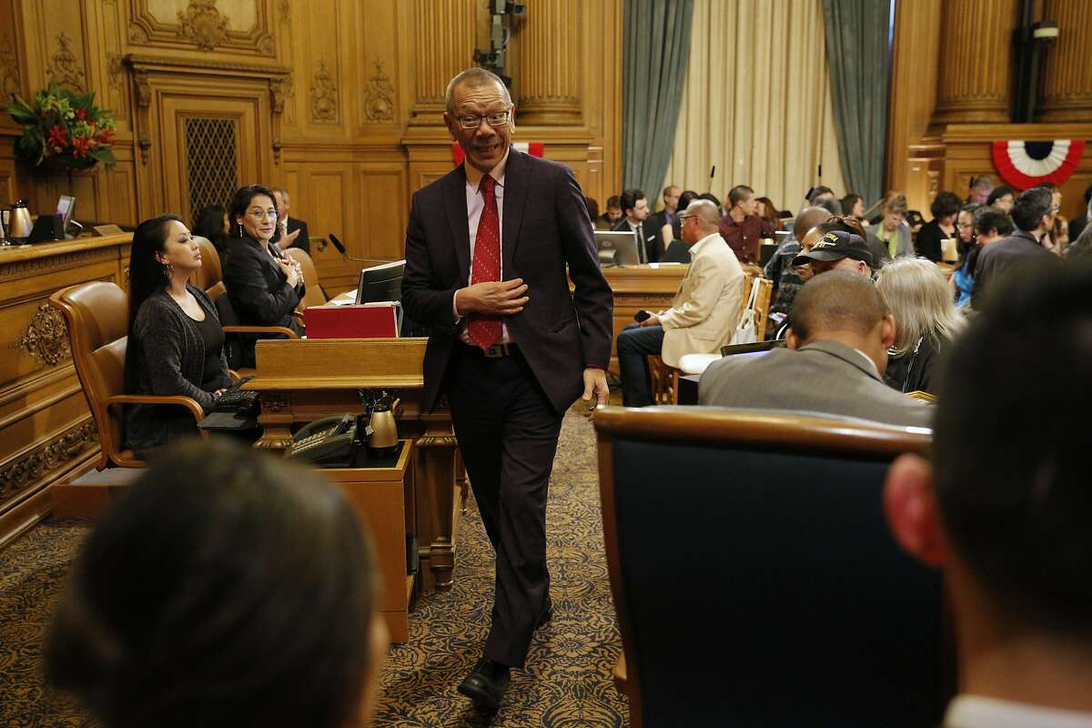 District 7 supervisor Norman Yee exits momentarily during public comment before a vote for the new president of the Board of Supervisors at City Hall on Tuesday, Jan. 8, 2019, in San Francisco, Calif. Yee and District 9 supervisor Hillary Ronen were nominated for the position.