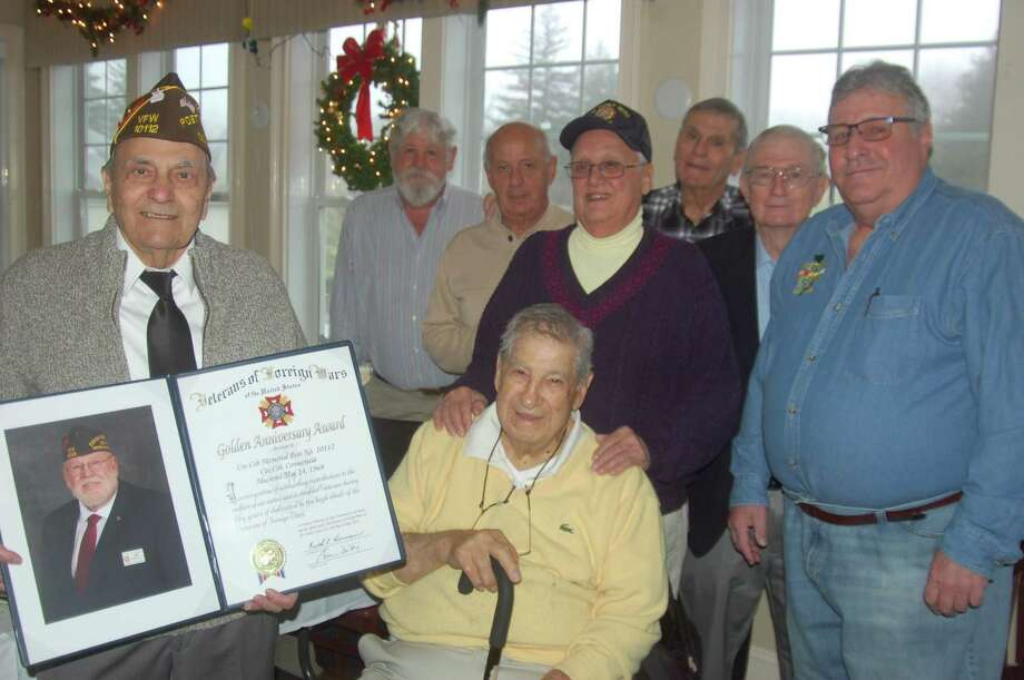 Members of the Cos Cob Veterans of Foreign Wars Post 10112 celebrated their 50th anniversary on Tuesday with the presentation of a formal citation from the national VFW for their decades of community service. From left, post members Anthony Marzullo, Regis Gmitter, Doc Orrico, Joe Orrico, Frank Tiriolo, Bill Cameron and Post Commander Joe Musich. At front is post member, and chaplain, Lou Caravella. Photo: Ken Borsuk / Hearst Connecticut Media