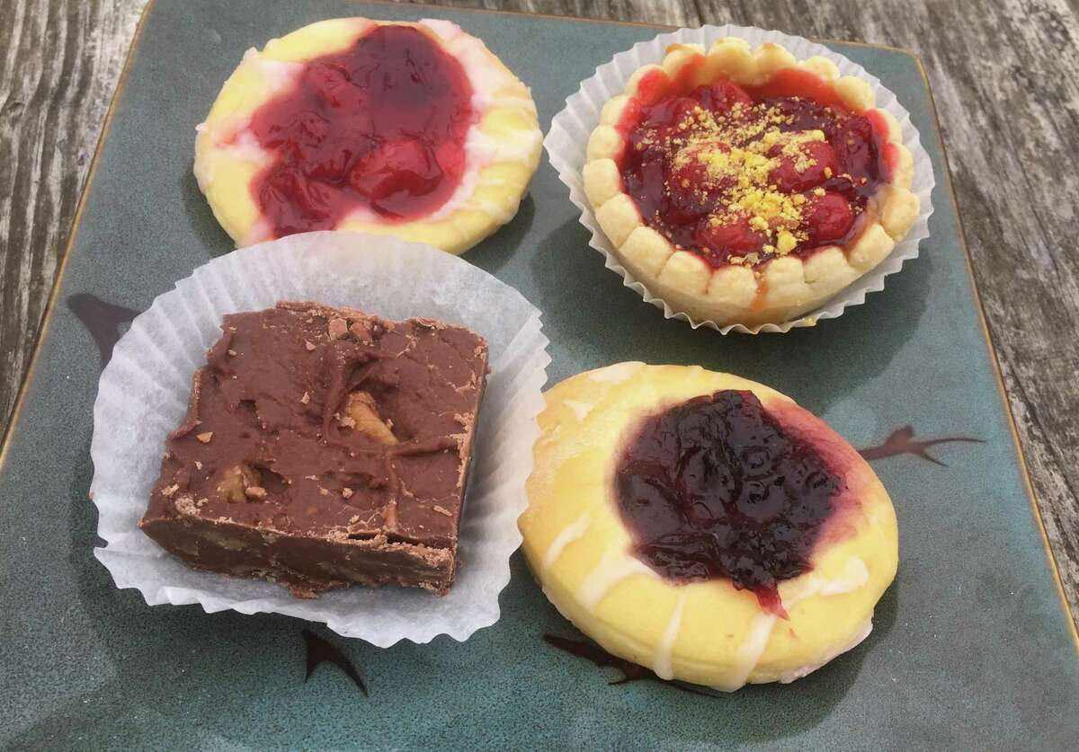 An assortment of sweets from Naegelin's Bakery include cherry and blueberry kolaches, a cherry tart and chocolate fudge.
