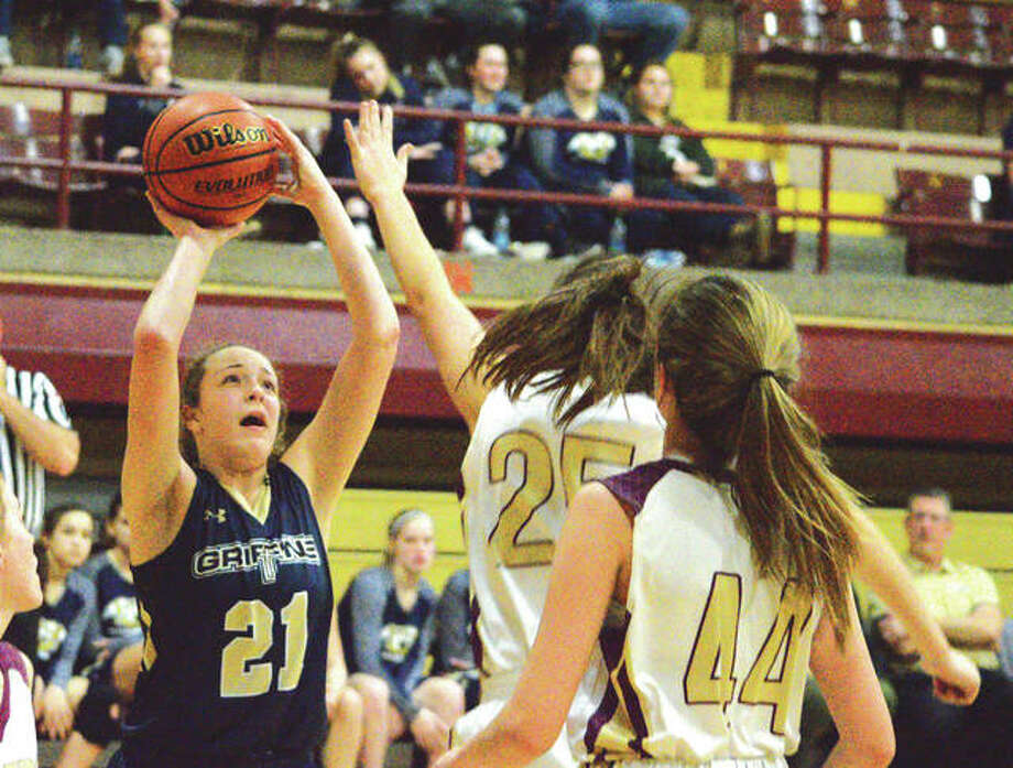 Father McGivney freshman Charlize Luehmann, left, puts up a shot during the third quarter of Monday's game at East Alton-Wood River. Photo: Scott Marion | For The Telegraph