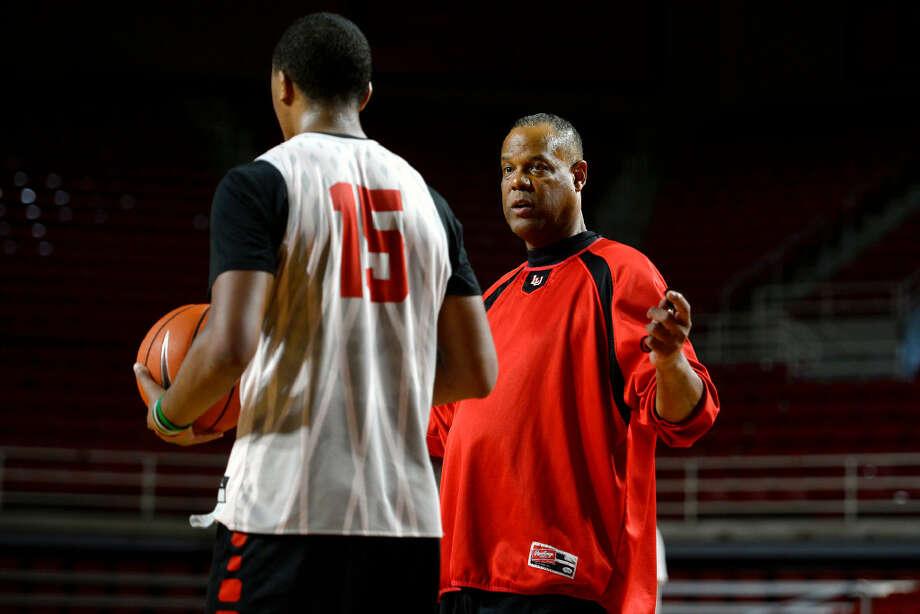Lamar men's basketball coach Tic Price talks with player T.J. Atwood during practice on Thursday.  Photo taken Thursday 8/10/17 Ryan Pelham/The Enterprise Photo: Ryan Pelham