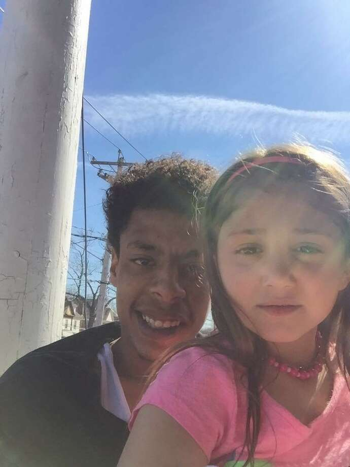 Justus Booze is seen with Olivia Torres, then age 7, who adored him as the only father figure she knew, according to her mother. (Family photo)