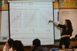 Math teacher Dayna Soares goes over a class assignment reviewing linear equations, slopes and reciprocals during her Algebra II class at Mission High School on Tuesday, January 8, 2019 in San Francisco, Calif.